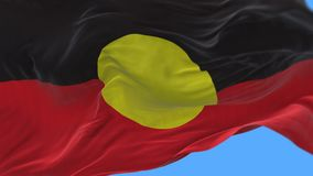 4k AUSTRLIA ABORIGINES Aboriginal flag slow waving in wind.alpha channel. 4k seamless Close up of AUSTRLIA ABORIGINES Aboriginal flag slow waving with visible stock video footage
