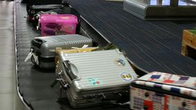 4k baggage claim in international airport. various suitcases on conveyor belt at the airport. luggage travels on a conveyor belt.  stock footage