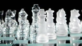 4K. Beautiful glass chess, black background stock video footage