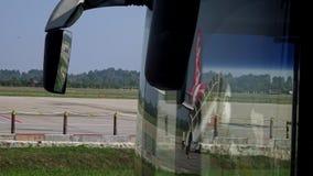 4K Beauty reflection plane on glass bus in international airport Siem Reap stock video