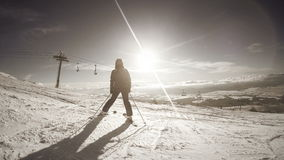 4K black and white footage: Female skier getting some rest on the top of the mountain enjoying the view stock video footage