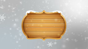 4K Blank wooden board sign with falling snowflake over gray abstract background for winter promotion and christmas celebration stock video footage