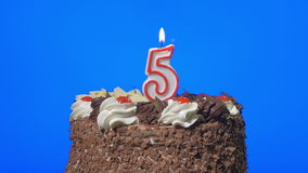 4k - Blowing out number five birthday candle on a delicious chocolate cake, blue screen. 4k Blowing out number five birthday candle on a delicious chocolate cake stock footage