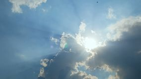 4K. blue sky cloudy with sun light beam with bird flying with natural sound
