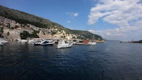 4K. Boats tied in the port of Old Town of Dubrovnik, Croatia. View from a ferry. stock footage