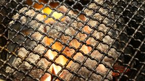 4K burning coal. close up of red hot coals glowed in the stove under BBQ Grill and glowing coals. stock footage