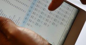 4k Businessman browsing financial news on smartphone stock video
