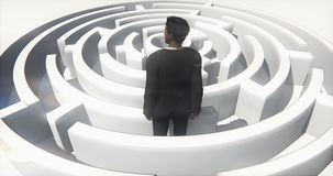 4k a businessman standing in the maze. stock video