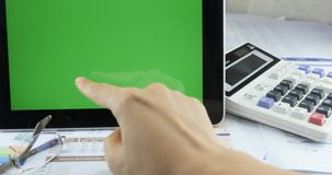 4k Businessman working on tablet & hand finger touch ipad green screen. stock footage
