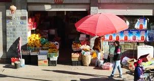 4k busy traffic & crowd in Shangri-La street,Fruit stand & Minority women. stock video footage