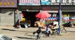4k busy traffic & crowd in Shangri-La street,Fruit stand & Minority women. stock footage