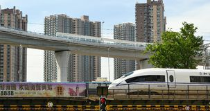 4k busy urban traffic,high-speed rail slowly pulling out under overpass,china. stock video