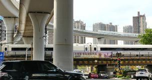 4k busy urban traffic,high-speed rail slowly pulling out under overpass,china. stock footage