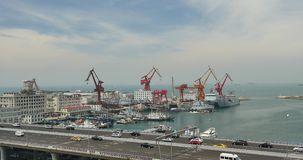 4k busy urban traffic on overpass,container terminal,QingDao china. stock video footage