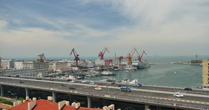 4k busy urban traffic on overpass,container terminal,QingDao china. stock footage