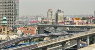 4k busy urban traffic on overpass,urban morden building,QingDao china. 4k busy urban traffic jam highway,Overpass interchange,urban morden building,QingDao stock footage