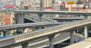 4k busy urban traffic on overpass,urban morden building,QingDao china. 4k busy urban traffic jam highway,Overpass interchange,urban morden building,QingDao stock video footage