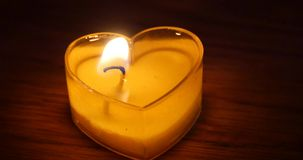 4k Candles burning in the night,heart shape,Merry Christmas And Happy New Year. stock footage