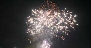 Celebration firework exploding and glow over dark background with dark and grain processed. 4K Celebration firework exploding and glow over dark background with stock video footage