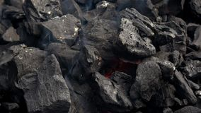 4K. Charcoal fire for barbecue. Smoke and flames. Hot coal and flame in barbecue stock footage