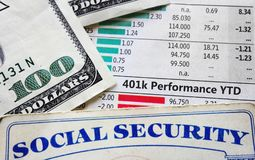 401k charts and social security. 401k stock chart with social security card and cash royalty free stock photos