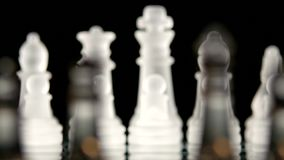 4K. Chess game board  on black background stock footage