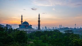 4K Cinematic Time Lapse Footage of Federal Territory Mosque in Kuala Lumpur. During colourful sunrise with Kuala Lumpur city skyline on the background stock footage