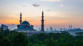 4K Cinematic Time Lapse Footage of Federal Territory Mosque in Kuala Lumpur. During colourful sunrise with Kuala Lumpur city skyline on the background stock video