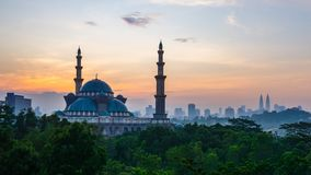 4K Cinematic Time Lapse Footage of Federal Territory Mosque in Kuala Lumpur. During colourful sunrise with Kuala Lumpur city skyline on the background stock video footage