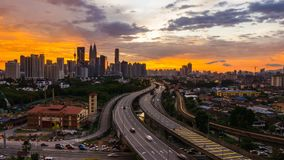 4K Cinematic Zooming out Time Lapse Footage of Kuala Lumpur city skyline during colourful sunset.
