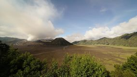 4K cinematic Zooming Out Time Lapse of Mount Bromo volcano in the afternoon.