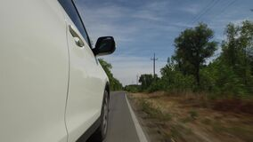 4K close-up car driving on rural road, pov view wheel spinning, nature landscape