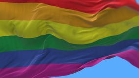 4k Close up of gay pride rainbow flag slow waving in wind.alpha channel. 4k seamless Close up of gay pride rainbow flag slow waving with visible wrinkles.A stock footage