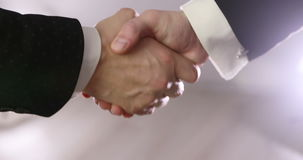 4K Close up on hands of 2 business people shaking hands indoors. Handshake of business partners stock video
