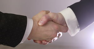 4K Close up of two unrecognizable business partners shaking hands. Handshake of 2 business people stock video