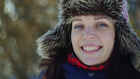 4K Close up woman portrait. Beautiful blue-eyed young woman smiles to the camera. stock footage