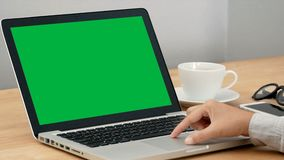4K. close-up woman working with notebook laptop, using finger with keyboard and touchpad for slide and zoom in, zoom out. computer. Laptop with blank green stock video footage