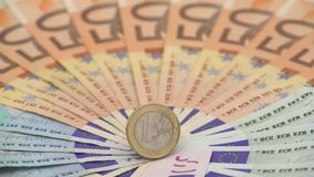4K Closeup of a coin one euro with banknotes of different values. Cash money. Background. Real hundred euros. Good earnings. Issuing salary. Credit percent stock video footage
