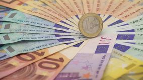 4K Closeup of a coin one euro with banknotes of different values. Cash money stock video footage