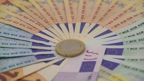 4K Closeup of a coin one euro with banknotes of different values. Cash money stock footage