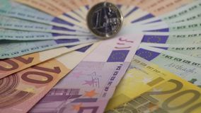 4K Closeup of a coin one euro with banknotes of different values. Cash money. Background. Real hundred euros. Good earnings. Issuing salary. Credit percent stock video
