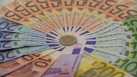 4K Closeup of coin two euros with banknotes of different values. Cash money. 4K Closeup of a coin two euros with banknotes of different values. Cash money stock video footage
