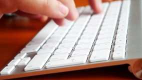 4K closeup view of human typing some text on computer keyboard. stock footage