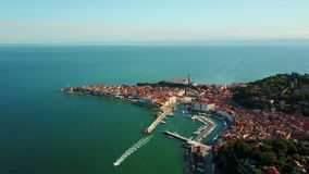 4K Compilation Video. Flight over old city Piran in the morning, aerial view with Tartini Square and St. George`s Parish Church stock footage