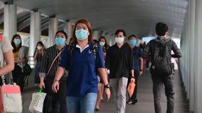 4K Crowded asian people wear face mask walking in pedestrian walkway