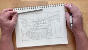 4k custom kitchen photo appears over artist drawing on pad of paper.  stock video