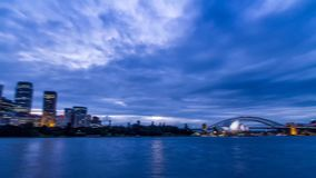 4k day to night time lapse seascape panorama on Australian cityscape of Sydney modern architecture bright light skyline stock video footage