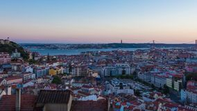 4K day to night timelapse of Lisbon rooftop from  Senhora do monte miradouro viewpoint in Portugal - UHD. 4K day to night timelapse of Lisbon rooftop from stock footage