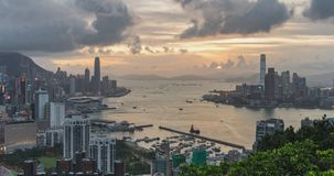4K DCI day to night time-lapse of landscape or cityscape of Hong Kong island, Victoria harbour, and Kowloon city stock footage
