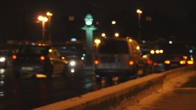 4k defocused night city traffic with cars and tram. Night city Saint-Petersburg traffic street with cars, tram and highway transport bridge on the background out stock video footage